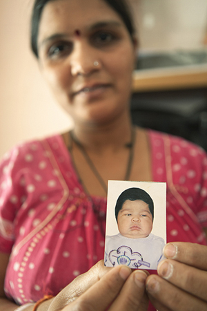 Surrogate mother with a picture of her child